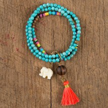 Turquoise Bead Lucky Elephant Bracelet Features turquoise stone beads accented with a sweet lucky elephant charm, large wooden bead charm and a neon pink hassle. Pris: 249:-