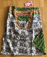 Grey Asha long reversible snap skirts, adjusts to your size and comes with a removable zippered pocket. 56 cm long. 799:-