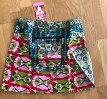 Pink Asha short reversible snap skirts, adjusts to your size and comes with a removable zippered pocket. 38 cm long. 699:-
