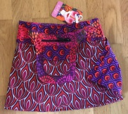Purple Kids Asha reversible snap skirts, adjusts to your size and comes with a removable zippered pocket. 29 cm long. 499:- (4-10years)