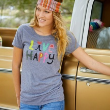 "Grey ""Live Happy"" Perfect Fit Tee 50% polyester 25% cotton 25% rayon. Runs true to size. Hemline hits at the hips.50% polyester, 25% cotton, 25% rayon Size: S M & L Pris: 349:-"