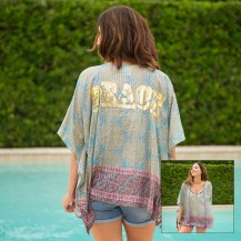 699:-Peace Tinsel Kaftan V-neck with tassels and metallic gold printing across back. 100% cotton Onesize