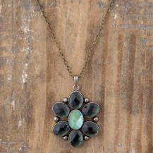 199:-Indigo Pendant Necklace 28in Chain faceted rhinestone and a hidden message make this custom pendant extra special. Sentiment: Do what you Love